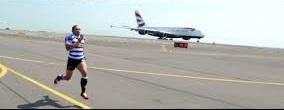 man running from plane